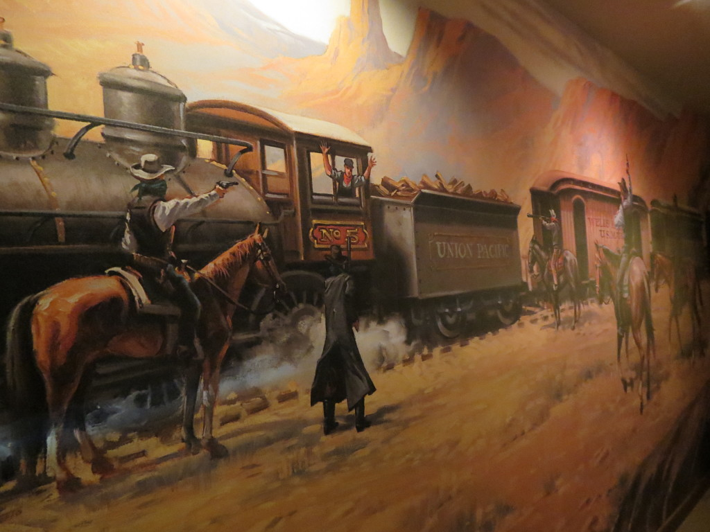 Mural on wall of Jesse James suite at Chateau Avalon
