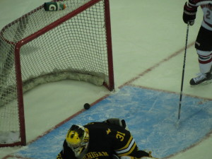 UNO scores  as puck gets past Michigan Tech goalie