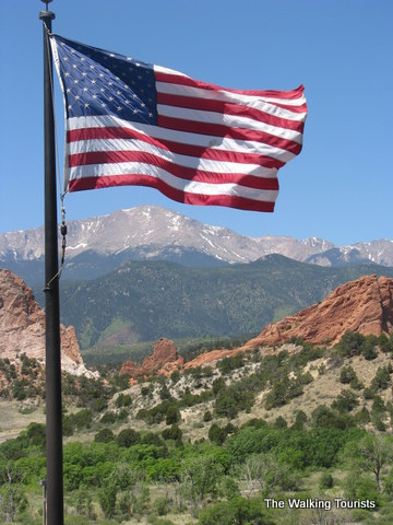 American flag flying high near the mountains of Colorado