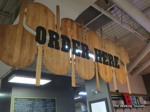 Paddleboard 'Order Here' sign at the renovated Bene