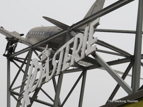 The Roasterie sign w/a plane