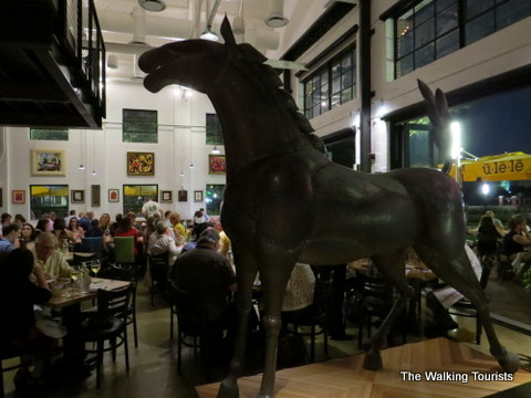 Art pieces such as this horse are located throughout the Ulele Restaurant