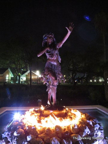 Ulele statue in front of Ulele Restaurant at night