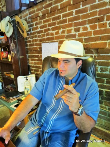 Showing off cigar at his shop in Ybor City