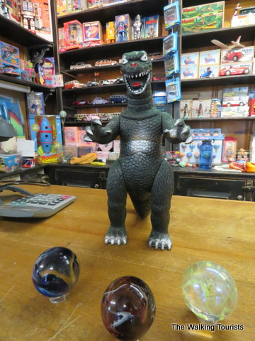 Godzilla eyeing some marbles at Moon Marble