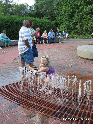 Playing in the fountain waiting for it to turn dark for the lanterns at Missouri Botanical Gardens