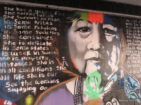 The mural features faces of Native Americans through history