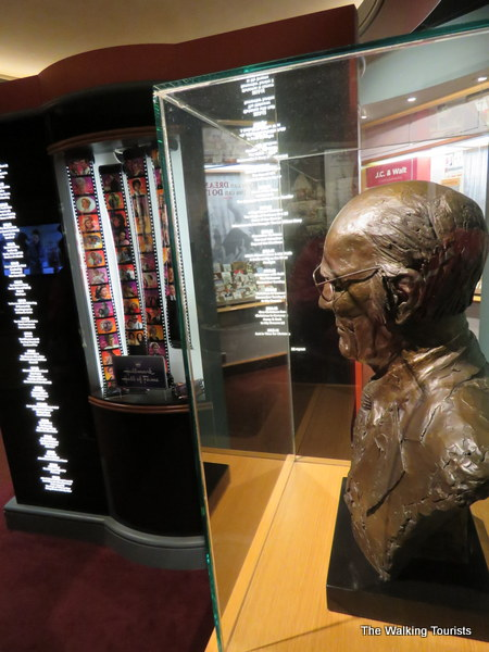 Bust of Hall overlooks the list of his company's award-winning movies and shows.
