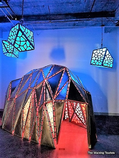 A tent-like piece created by acrylic, LED lights and stainless steel.