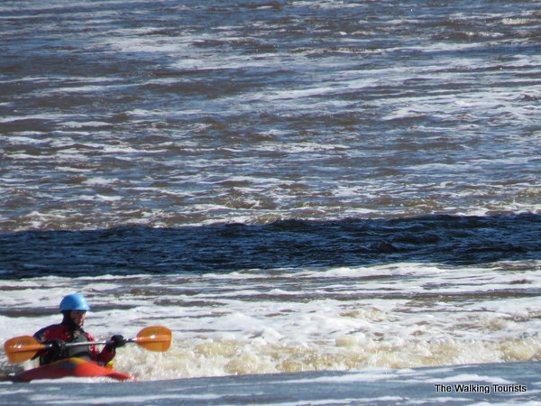 A kayaker takes on the rapids on the Cedar River near downtown Charles City.