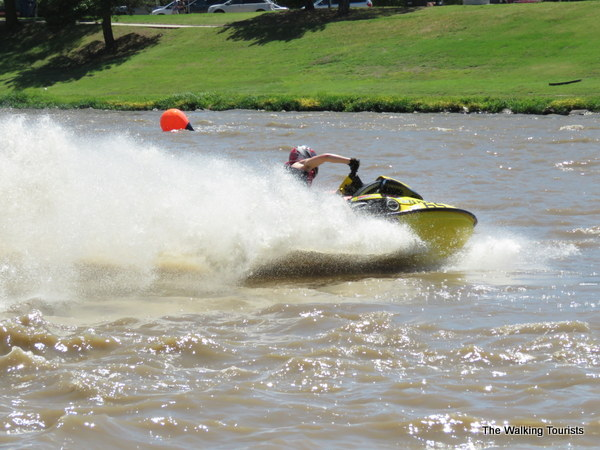 Jet ski racer rounds a buoy on the river.