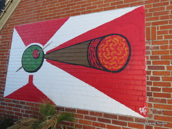 A flag mural using a cigar in the middle