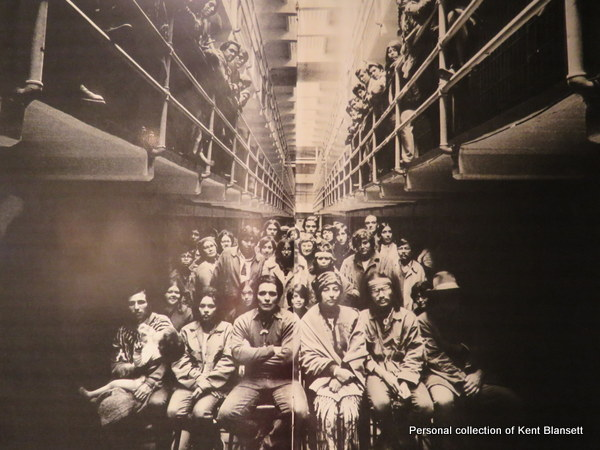 A photo of IAT members inside the main cell block at Alcatraz.