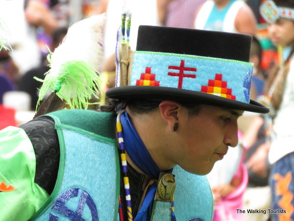A dancer's regalia includes spiritual or family heirlooms.