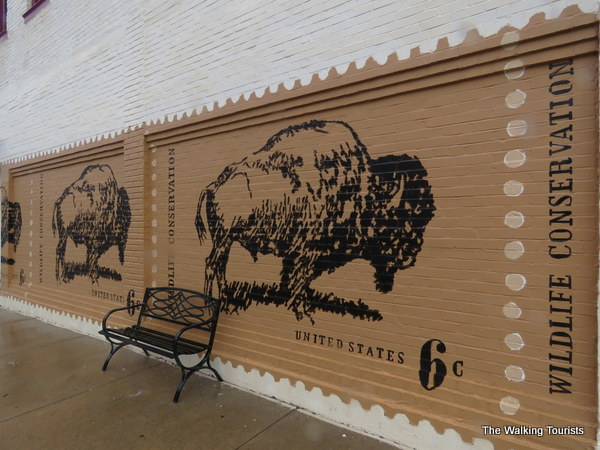A mural featuring bison painted on a downtown building.