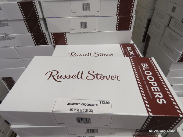 Russell Stover chocolate boxes stacked up for sales.