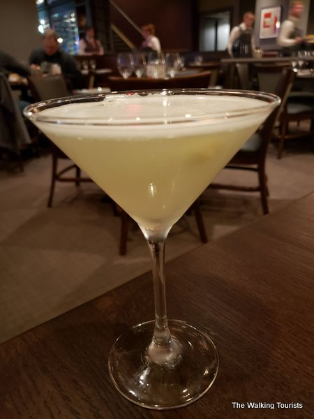 Lisa enjoyed her pineapple martini, which the server created tableside.