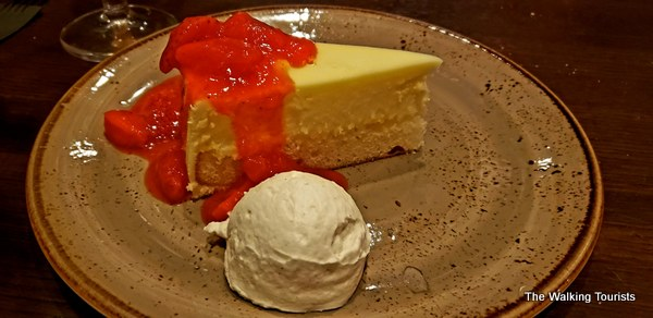 Strawberry cheesecake and whipped cream.