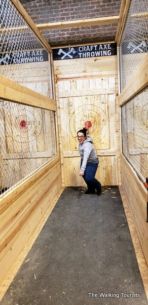 """Katrina """"threw"""" her axe so hard that she had to take a different approach to pull it out of the target."""