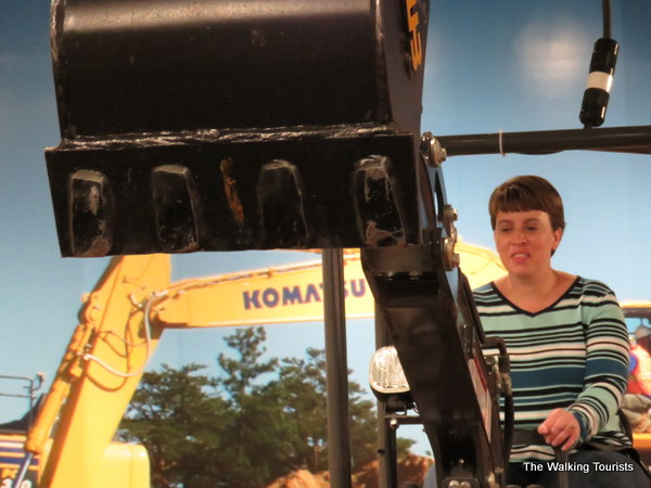 Lisa in action operating the excavator at Roseville's Extreme Sandbox Mini.