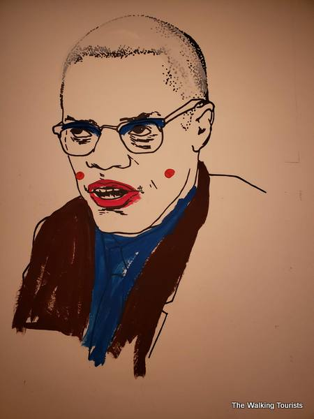 Malcolm X in an oil painting.