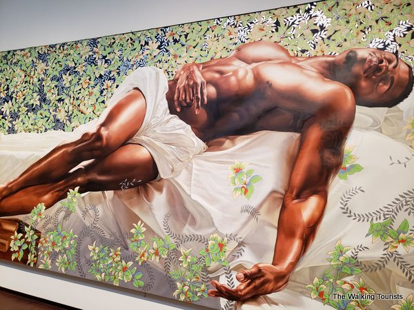 """""""Sleep"""" purports to counter the thought that black masculinity is threatening. Placing a sleeping man on a bed of flowers, artist Kehinde Riley seeks to change the mindset."""