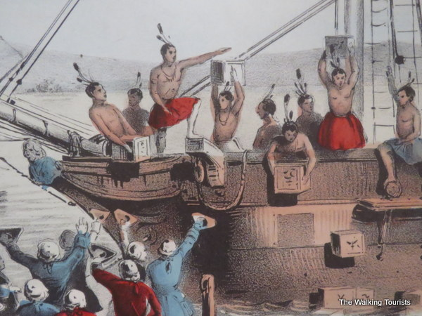 A replica of a painting portrays colonial protestors dressed as Native Americans throwing tea overboard in Boston.