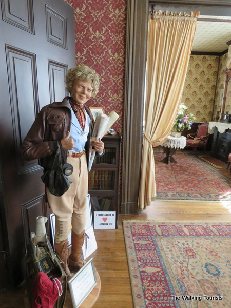 An Amelia lookalike mannequin greets visitors to the house.