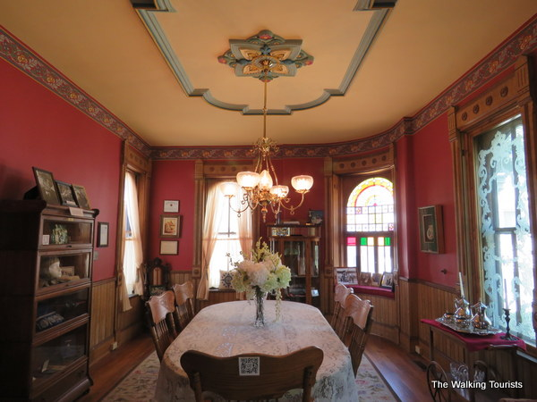 The dining room features artistic molding on the ceiling among the attractive features.