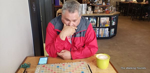Tim thinks about his next play for Scrabble.