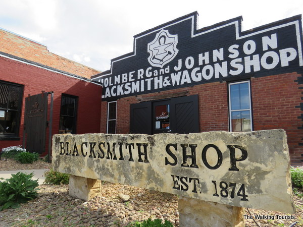 Blacksmith Coffee Shop sign in front of the building