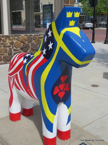 A dala horse statue half designed with American flag and the Swedish flag