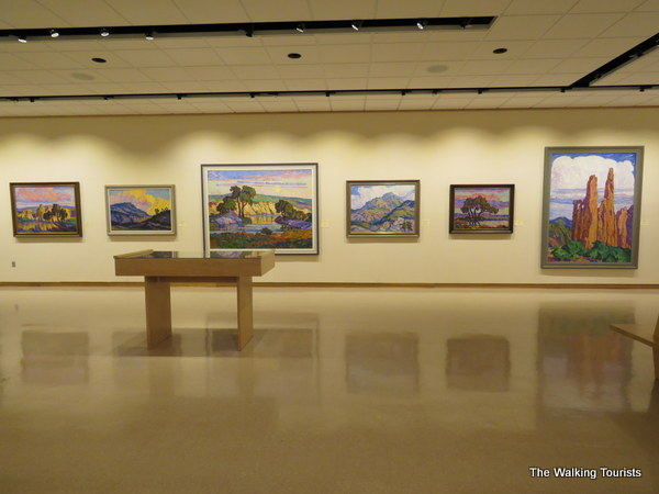 Art gallery with open floor and paintings on the far away wall