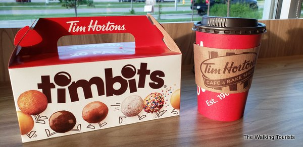 Box of donut holes and coffee