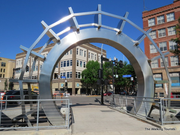 Paddlewheel statue with old buildings in the background