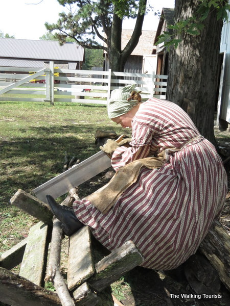 A farmhand cuts wood