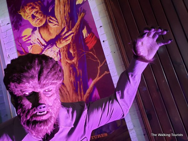 The Wolfman statue in front of the movie's poster